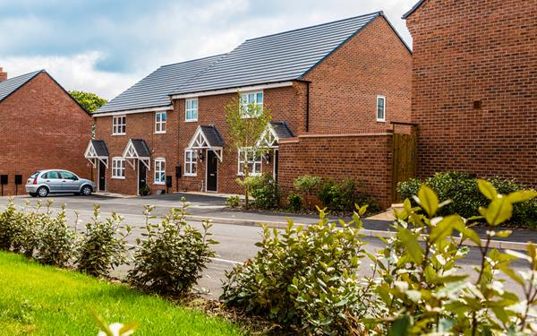 Exterior shot of four homes at Hackwood Park